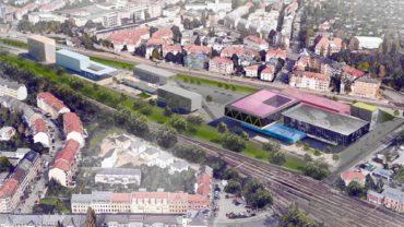 Links vier Gewerbegebäude, rechts das Sportzentrum, blau die Schwimmhalle. Visualisierung: Ipro