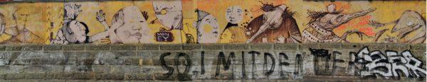 Wandbild an der Friedensstraße mit Werken von Artourette, Kumo, Andy K. und anderen.